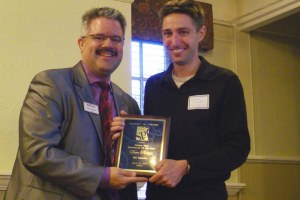 SPJ Colorado Pro chapter president Dennis Huspeni, left congratulates Pulitzer Prize-winning reporter Dave Philipps of The (Colorado Springs) Gazette, who received the Journalist of the Year award at the Top of the Rockies Awards presentation.